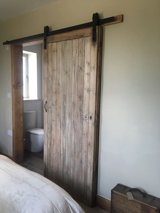 Sliding door to the ensuite wet room with shower