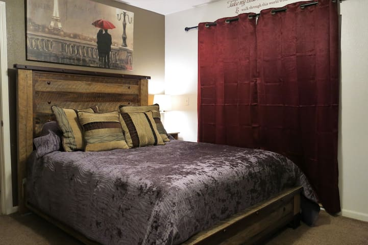 Master Bedroom: Queen size bed with full dresser and sliding door access to backyard