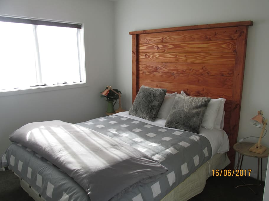 check out the custom headboard! A comfy bed is a must and this one is super comfy, complete with electric blanket to heat in winter