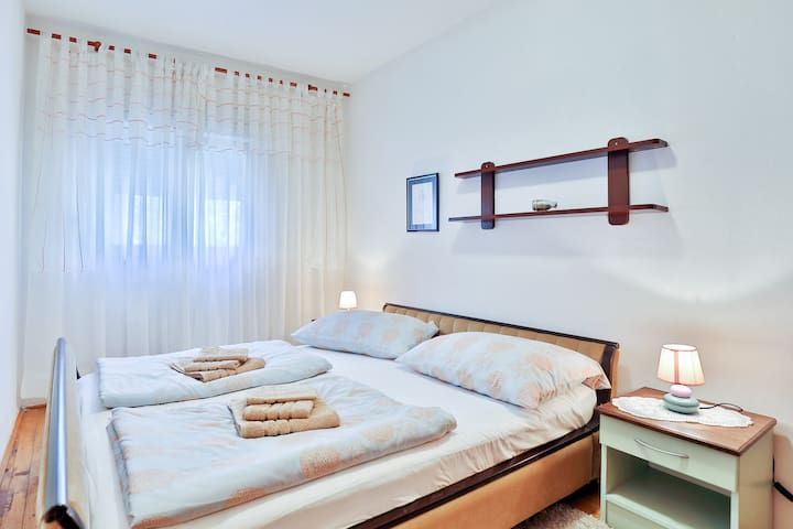 First bedroom with double bed.