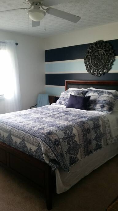 Furnished Bedroom with Queen size bed with luxury linens.