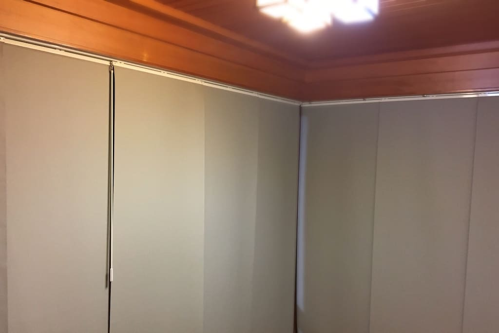 The tatami room is minimal. No door. Just hanging  curtains. Please be aware there is no lock.