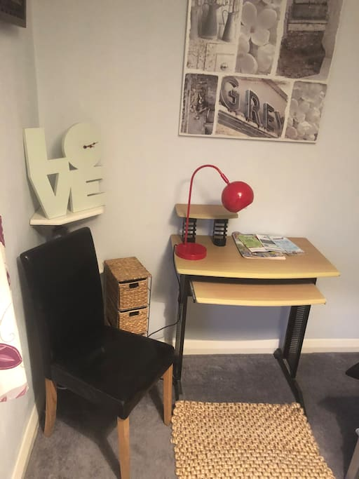 Desk in room with two chairs