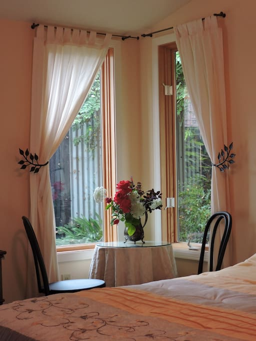 Corner windows with private view & table