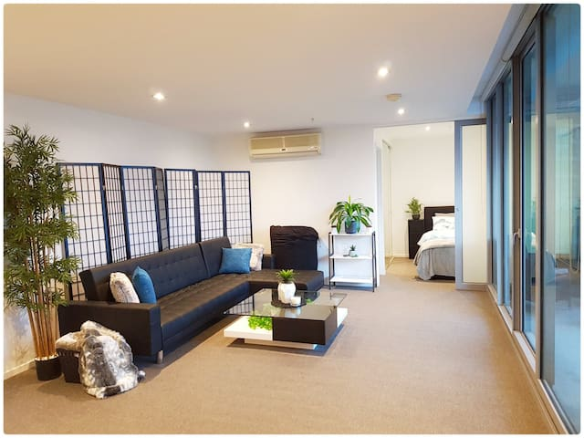 Huge open plan living area, plenty of space with a flexible living area overlooking the city skyline.