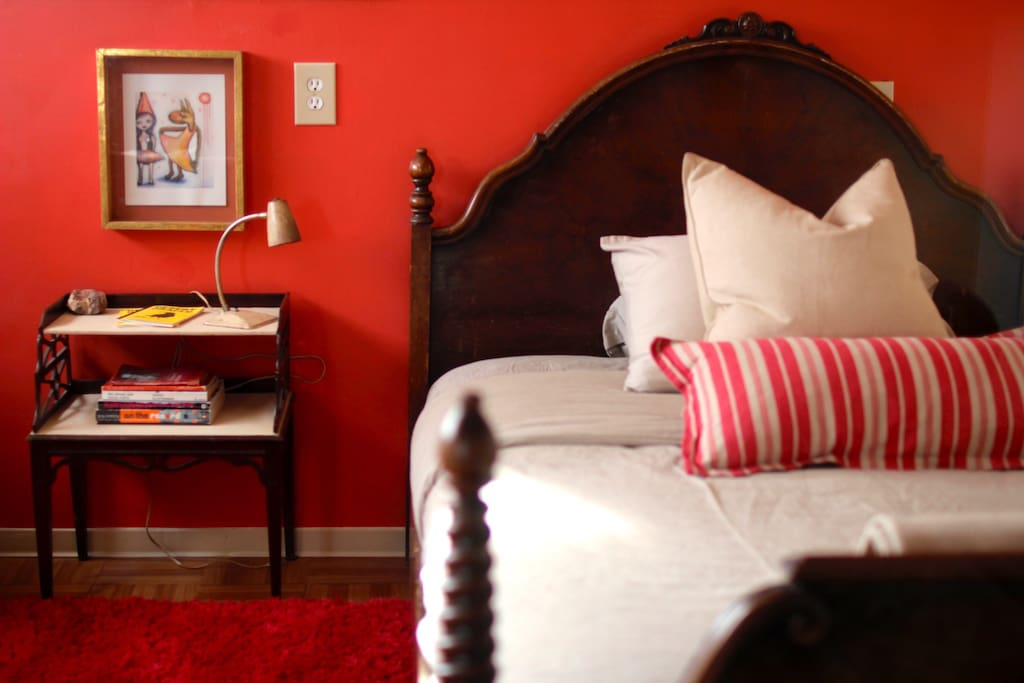Bedroom with antique full sized bed. (The Red Room)