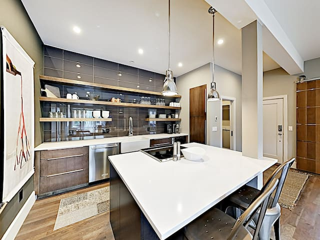 Before your mountain adventures, whip up hearty meals in the large, modern kitchen.