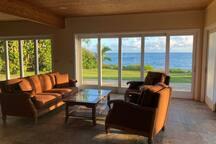 Ground Floor Indoor Outdoor living with slide away glass doors to the pool and ocean
