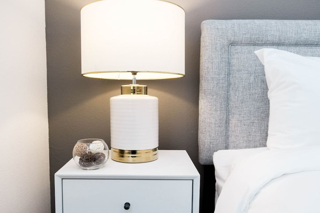 Read a story or two under the warm light of the bedside table lamps