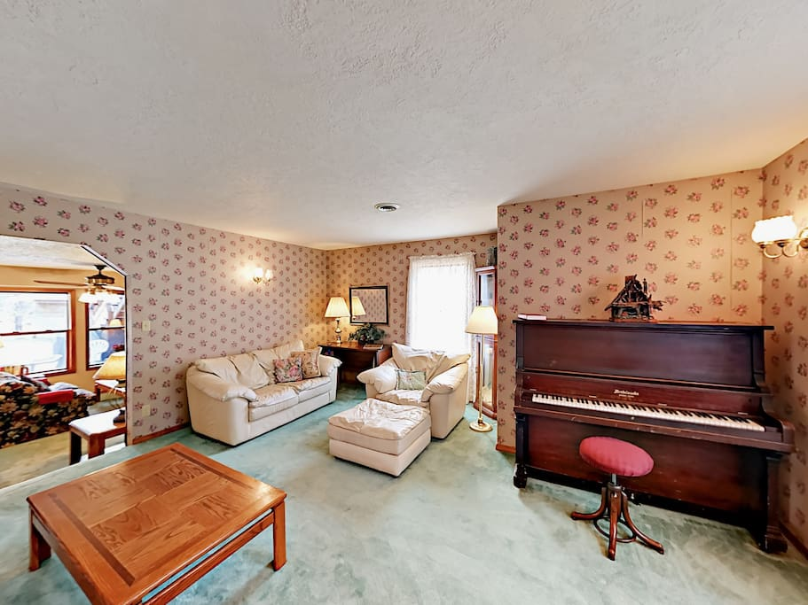 Play your favorite tunes on the piano in the living area.