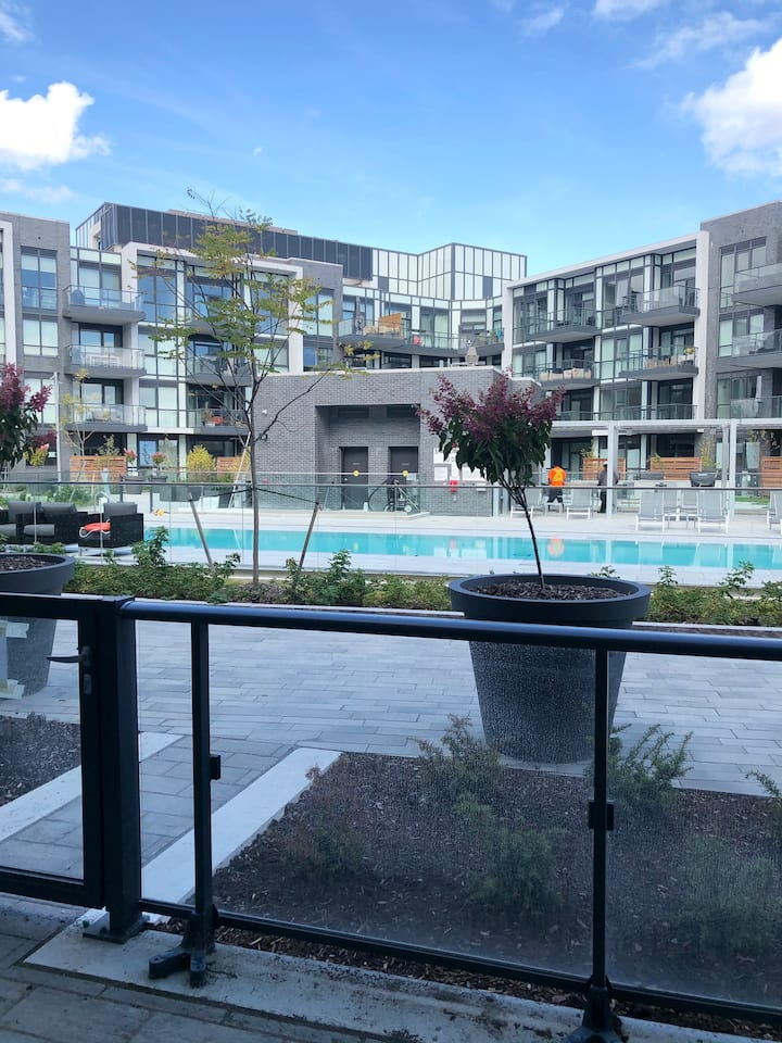 Two-bedroom condo with walkout to private pool.
