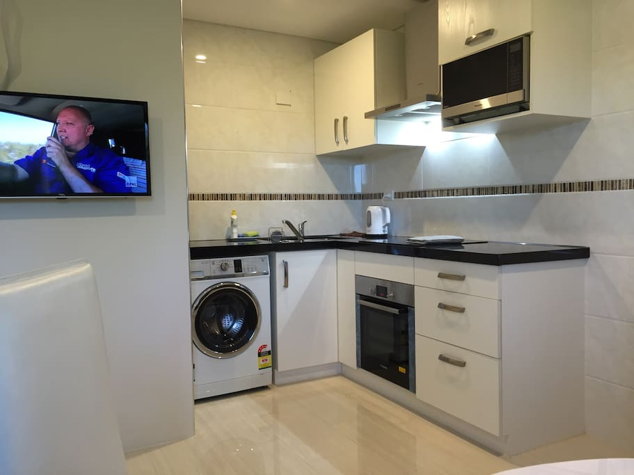 Private open kitchen with washing machine