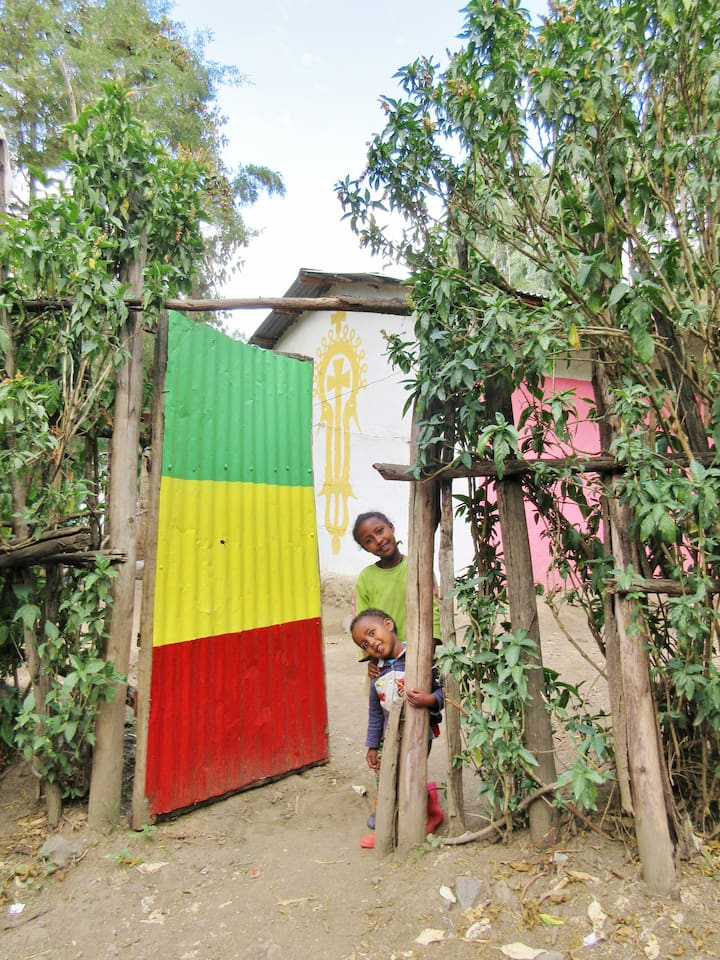 My Nephew and Niece are always happy to welcome guests to our compound, you will never loose your way here, just look out for the most brightly painted gate in lalibela!