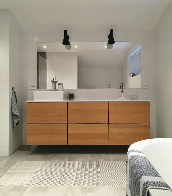Clean and comfortable bathroom. (You'll find towels in the upper right drawer.)