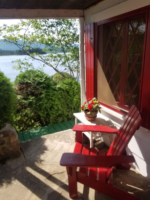 A classic adirondack chair in the entryway