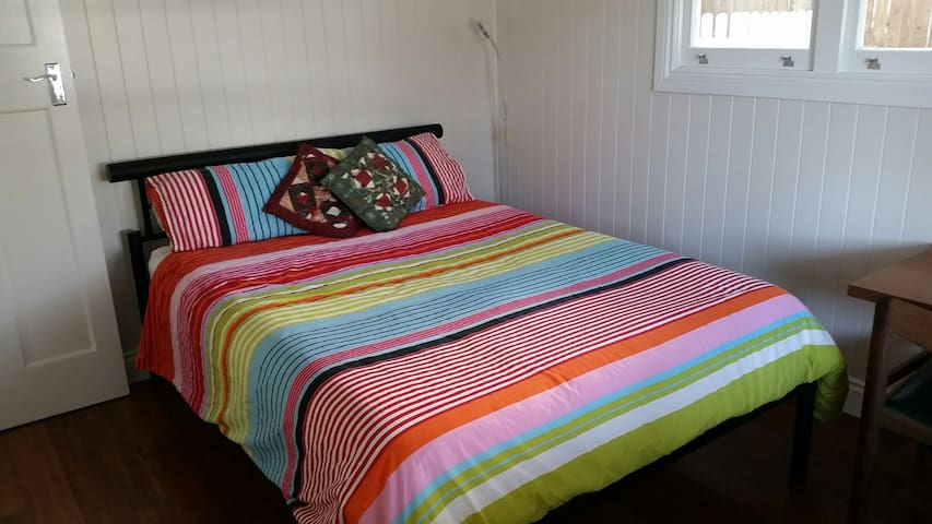 Cosy bedroom in newly renovated 'Old Queenslander'