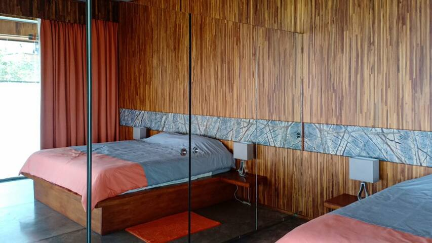 The comfortable bedroom is beautifully designed.