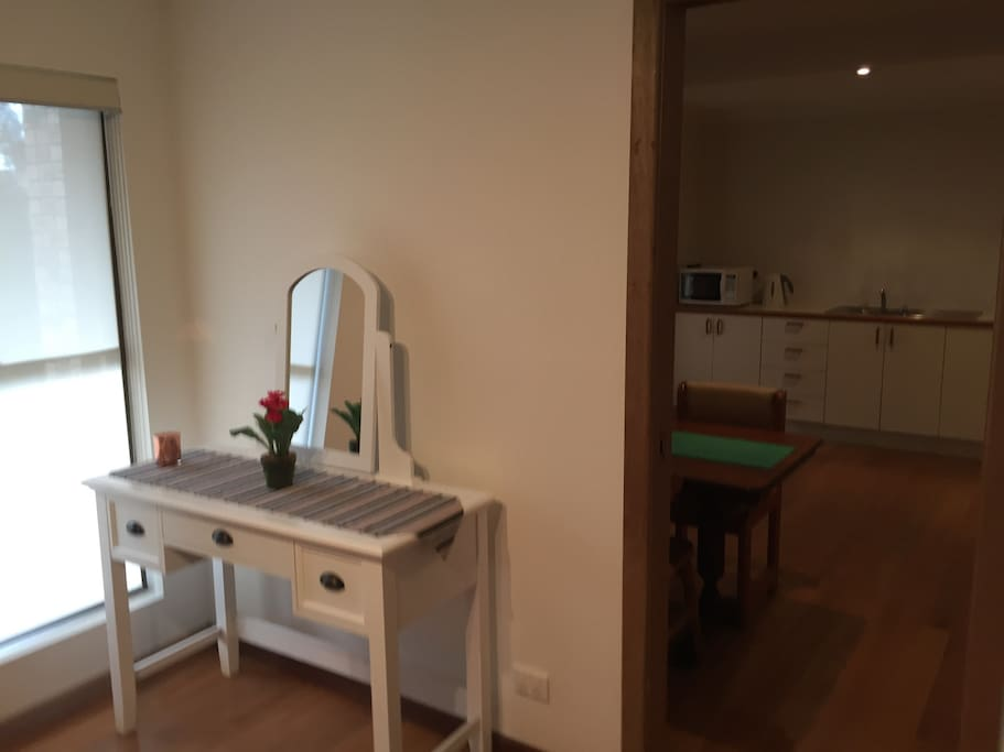 Dressing table/desk and unlimited wireless internet access. Bedroom adjacent to kitchen/living area (with lockable sliding door)