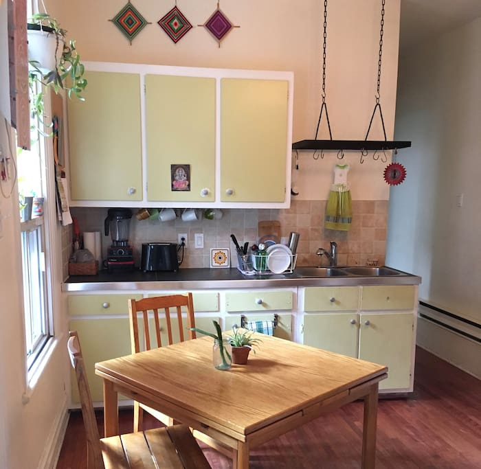 Bright and fully-equipped, the kitchen is perfect for cooking and gathering in.