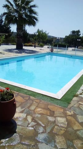 18' from the airport  a house with swimming pool