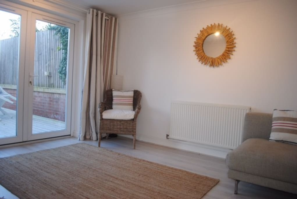 Bright sunny spacious living room. With patio doors to lovely private garden.