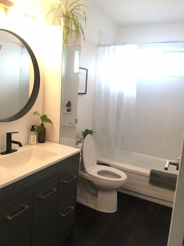 Full bathroom with tub and shower.
