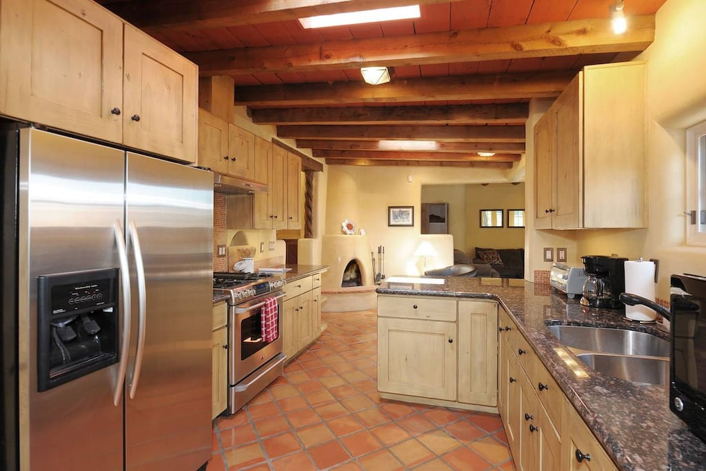 Kitchen with gas stove, toaster, coffee maker, and microwave