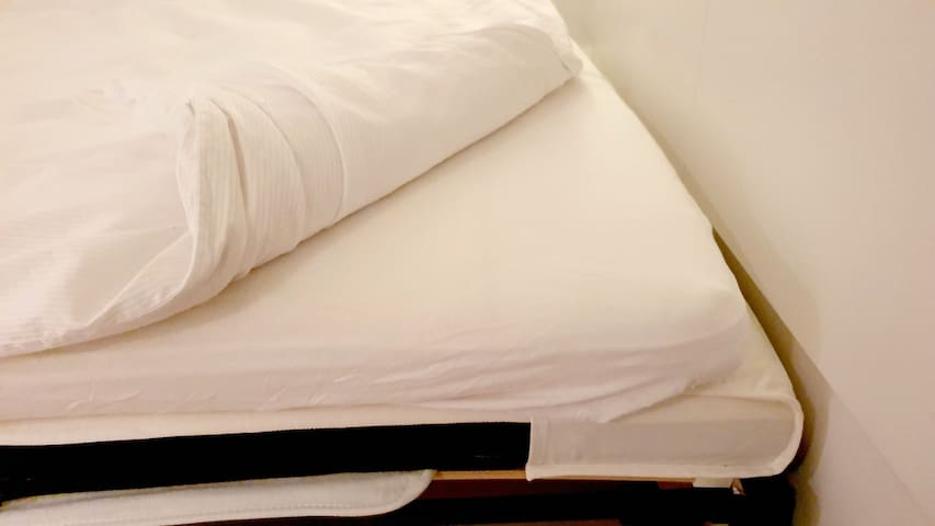 To increase comfortability further, the bed is equipped with a mattress pad