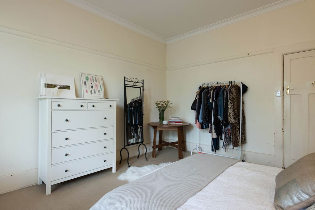 A clothes wrack for you to hang your items on and a lovely chest of drawers.