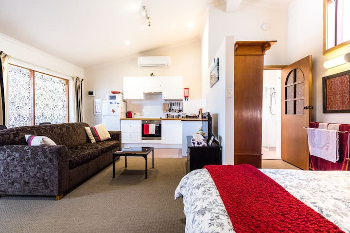 Welcome to your open plan studio apartment - with everything at your fingertips - modern and clean with high cathedral ceilings.