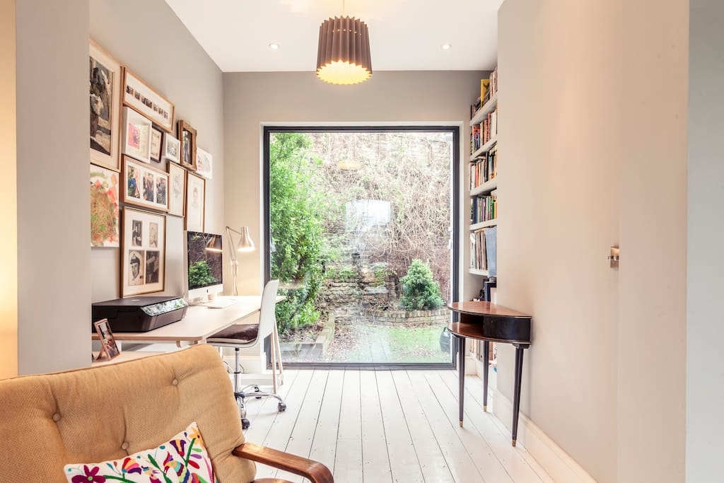 View from sitting room to office with floor to ceiling glass panel - lots of lovely natural light!