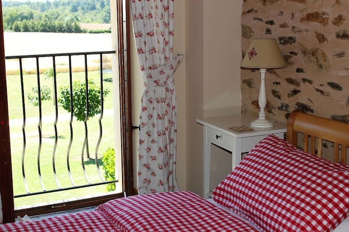 Twin Bedroom with Juliet balcony and views across the south facing garden