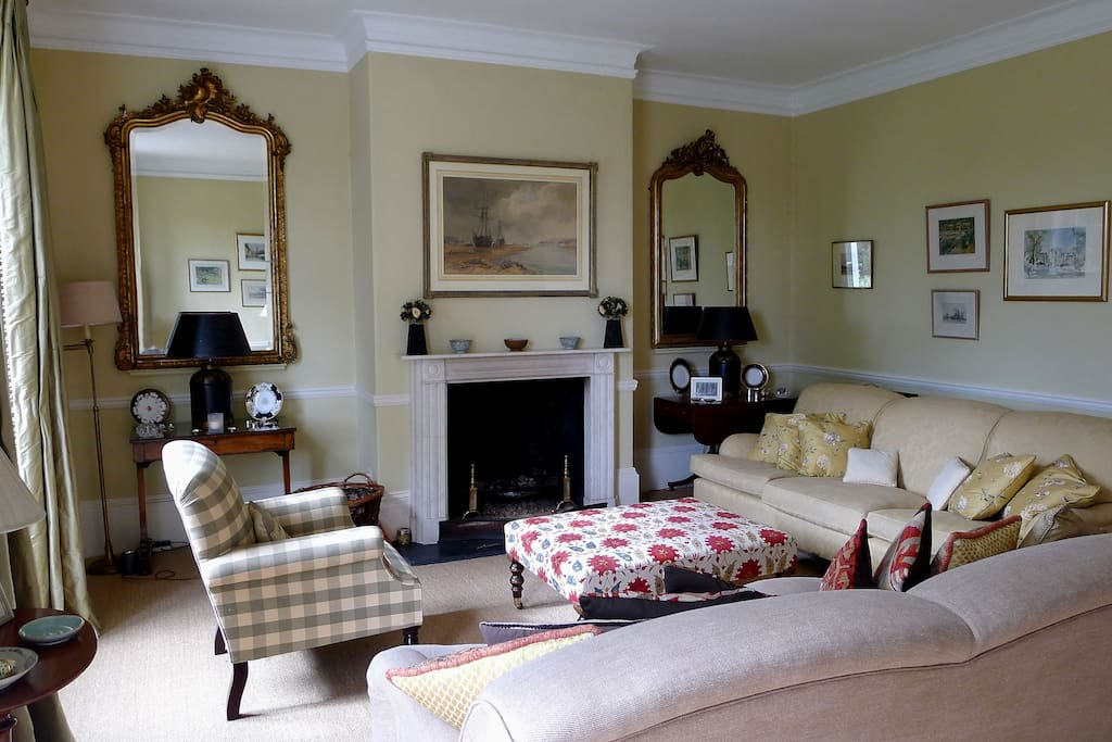 Drawing Room with open fire and French windows to terrace