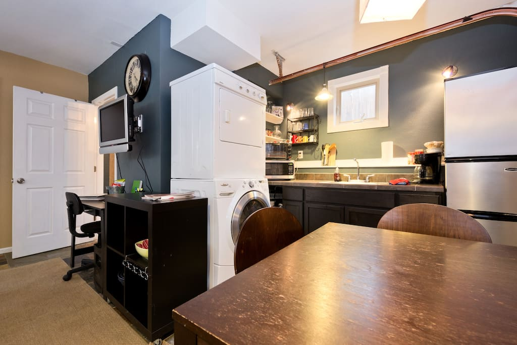 Well equipped kitchen with tile countertops, and lots of lighting! Stackable W/D in unit!