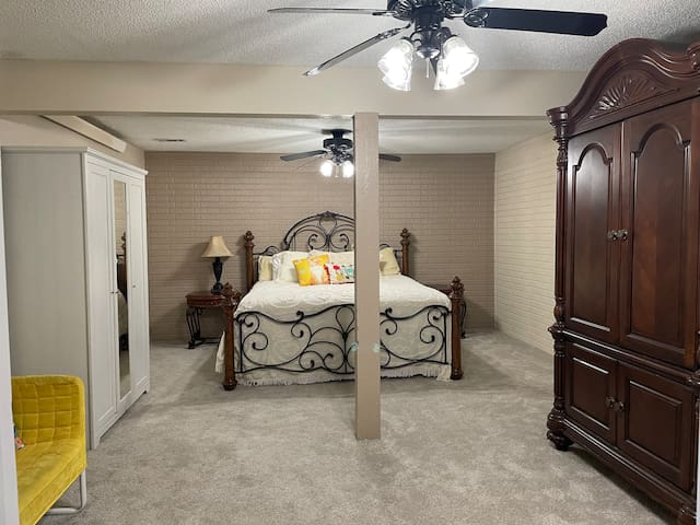"""Master bedroom suite with king bed, armoire with 40"""" TV, extra cabinet & closet for clothing, games & puzzles.  Couch & sitting area as well."""