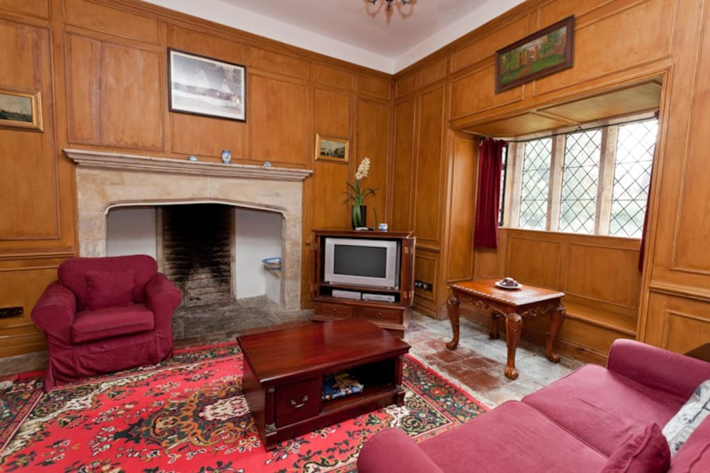 Oak paneled living room with gigantic inglenook fireplace