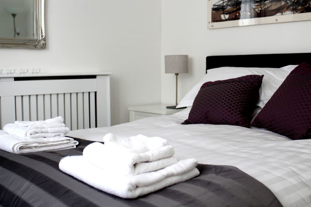 Blissful bed with Egyptian Cotton linens and feather & down pillows