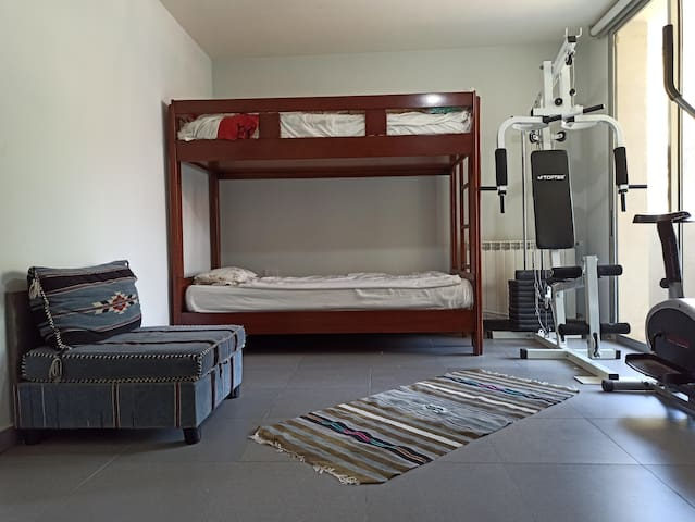 Master Bedroom nbr2 with gym equipment