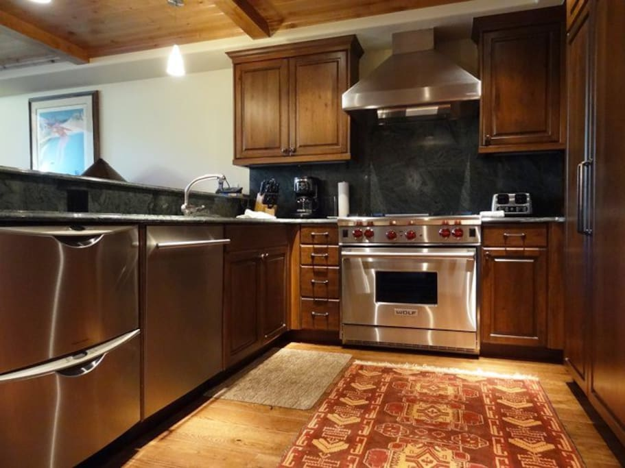 Fully-equipped gourmet kitchen with stainless steel appliances
