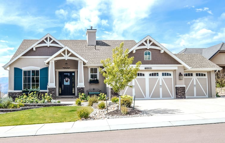 Distinctive cottage style mountain home greets you as you arrive. Guests use single bay driveway space and have separate entrance with Smart-lock into lower-level on the backside of the house.  Pathway around the right-side leads to the patio level.