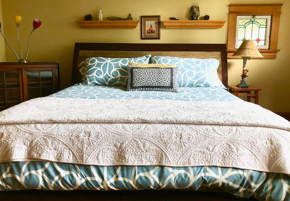 Beautiful comforter & quilt on king bed on second floor - light for night reading