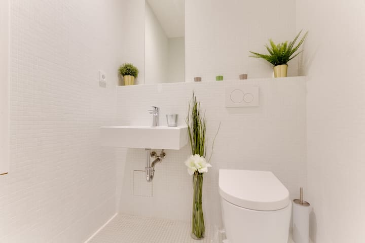 Clean and bright bathroom with a care package of  toiletries  for  our guests.