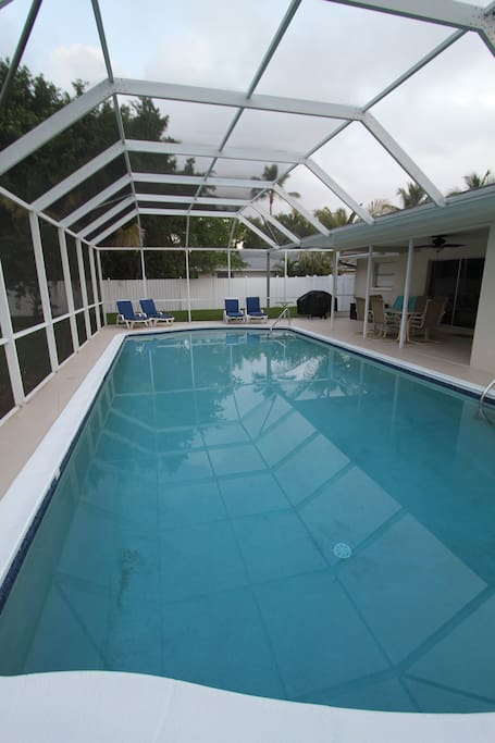 Beautiful large pool with pool toys and covers screened in lanai with gas grill.