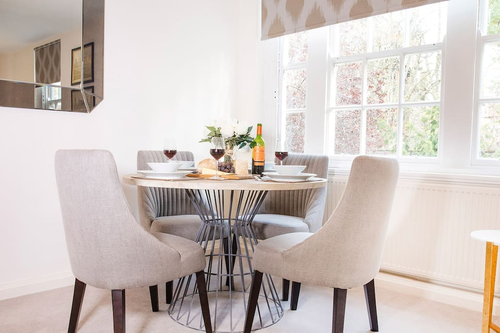 Dining table comfortably seats four guest for dinner