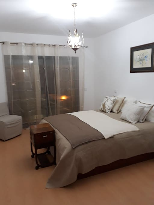 Master Bedroom  with ensuite bathroom - bedroom has an adjacent spacious balcony/terrace. King size bed.