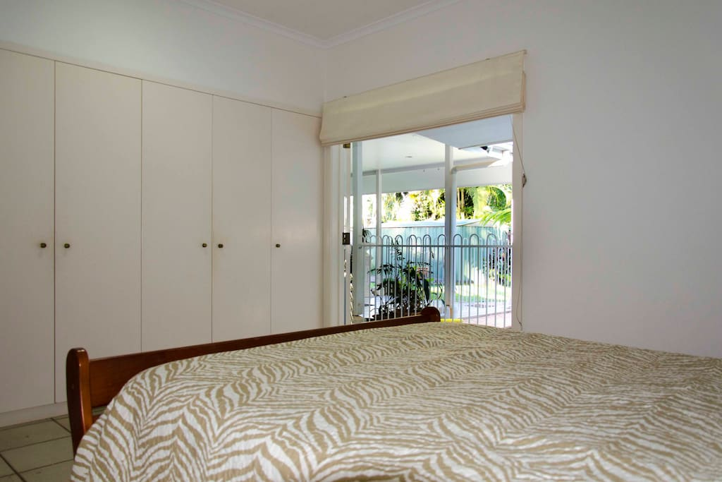 Bedroom includes lots of wardrobe storage and is light and breezy with direct access to poolside.