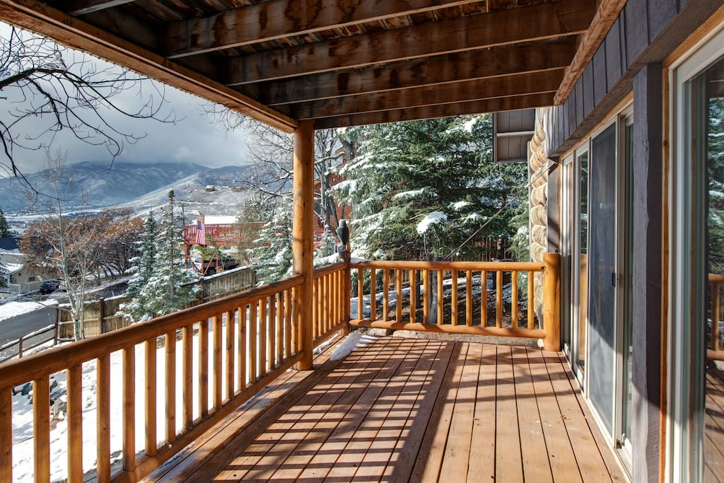 Everyone's favorite spot at this 6-bedroom house: the glorious mountain-view deck