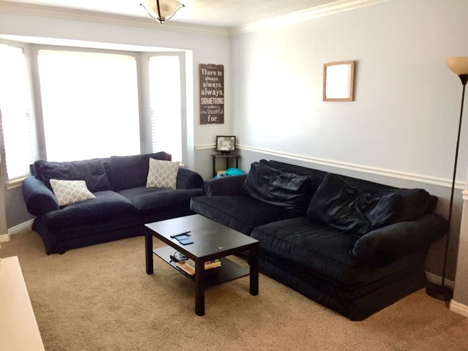 Living room with comfy couches & smart TV!