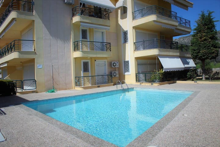 Sunny maisonette 150m from the beach with pool.