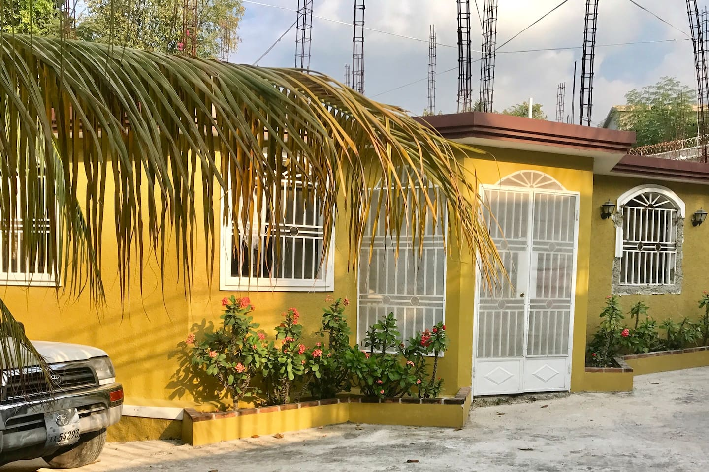 Beautiful Oasis in Haiti - Front of the house. This is a gated house with a guess house in the back. The guess house is not included.